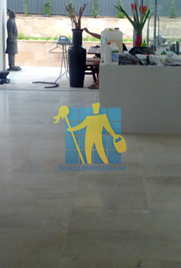 travertine tiles in large empty livingtoom large tiles after cleaning by tile cleaners
